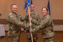 U.S. Air Force Lt. Col. Heather Wempe, 354th Force Support Squadron (FSS) incoming commander, accepts the 354th FSS guidon from Col. Chad Bondurant, 354th Mission Support Group commander during a change of command ceremony at Eielson Air Force Base, Alaska, June 14, 2019. Wempe assumed command from Lt. Col. Michael Ingram, who is now the commander of the 55th FSS at Offutt Air Force Base, Nebraska. (U.S. Air Force photo by Senior Airman Isaac Johnson)