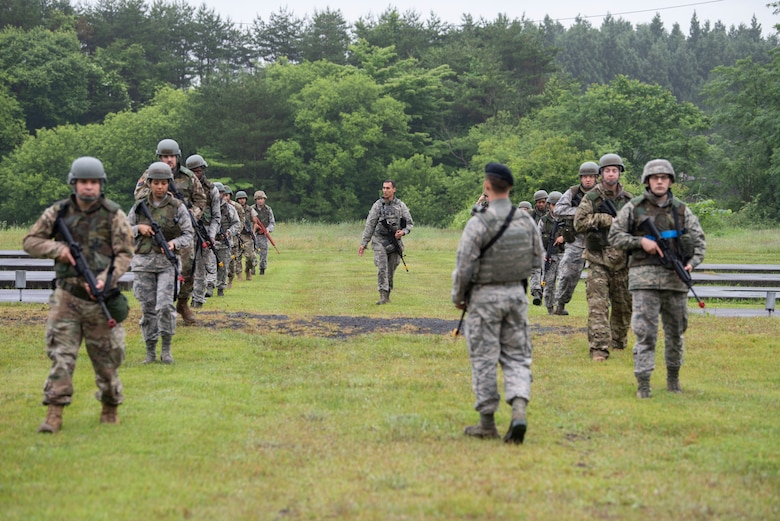 "Airmen with the 35th Logistics Readiness Squadron practice formation drills during an agile combat employment exercise at Misawa Air Base, Japan, June 28, 2019. The members practiced shooting techniques at ""Camp Defender,"" where they learned how to move, shoot and communicate during realistic training scenarios. (U.S. Air Force photo by Staff Sgt. Brittany A. Chase)"