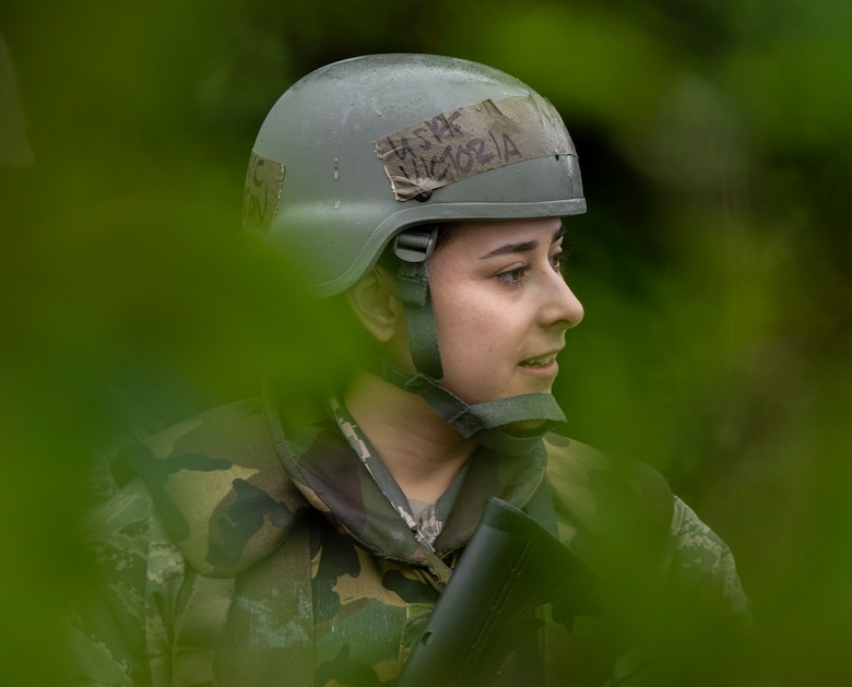 U.S. Air Force Airman 1st Class Victoria Johnson, a 35th Logistics Readiness Squadron property counselor, listens to instructions during an agile combat employment exercise at Misawa Air Base, Japan, June 28, 2019. Airmen from the 35th LRS participated in multiple exercises throughout the day, fortifying their self-aid buddy care skills and learning proper building clearance procedures. (U.S. Air Force photo by Staff Sgt. Brittany A. Chase)
