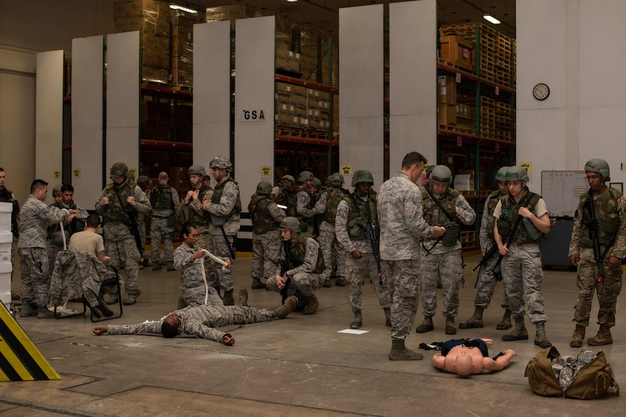 Airmen with the 35th Medical Group teach self-aid buddy care to 35th Logistics Readiness Squadron Airmen during an agile combat employment exercise at Misawa Air Base, Japan, June 28, 2019. Nearly 75 LRS Airmen learned proper tools and techniques to save lives in case of a real-real-world scenario. (U.S. Air Force photo by Staff Sgt. Brittany A. Chase)