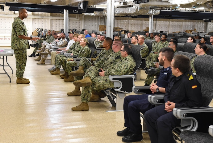 Capt. Frank Okata, commander, Task Force 63, addresses military and civilian crew members assigned to USNS Carson City in preparation for the 2019 Africa Partnership Station deployment, July 1, 2019.