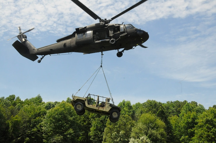 U.S. Soldiers with Alpha Company, 628th Aviation Support Battalion, 28th Expeditionary Combat Aviation Brigade sling load a Humvee to a UH-60 Black Hawk helicopter at Fort Indiantown Gap, June 12, 2019. The Humvee was flown to Schuylkill County Joe Zerbey Airport.