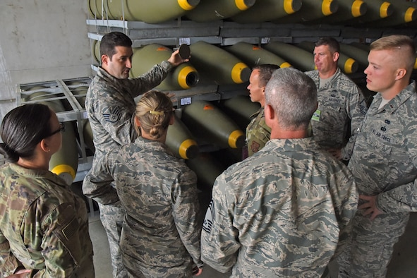 U.S. Air Force Airmen from the 118th Logistics Readiness Squadron, Tennessee Air National Guard, are briefed on the storage and operations of MK84 bombs June 10, 2019 at Ramstein Air Base, Germany.