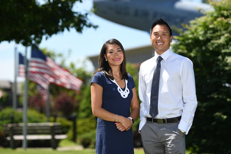 Tiffany Cote and Chris Lung pose for a photo near the F-86 Sabre static display on Hanscom Air Force Base, July 2. Both siblings are assigned to the same office on base where they hire acquisition professionals, and provide guidance on the federal acquisition process. Cote and Lung remember their father driving them by the F-86 when he was an engineer on base. The siblings have followed their parents footsteps into civil service. (U.S. Air Force photo by Mark Herlihy).