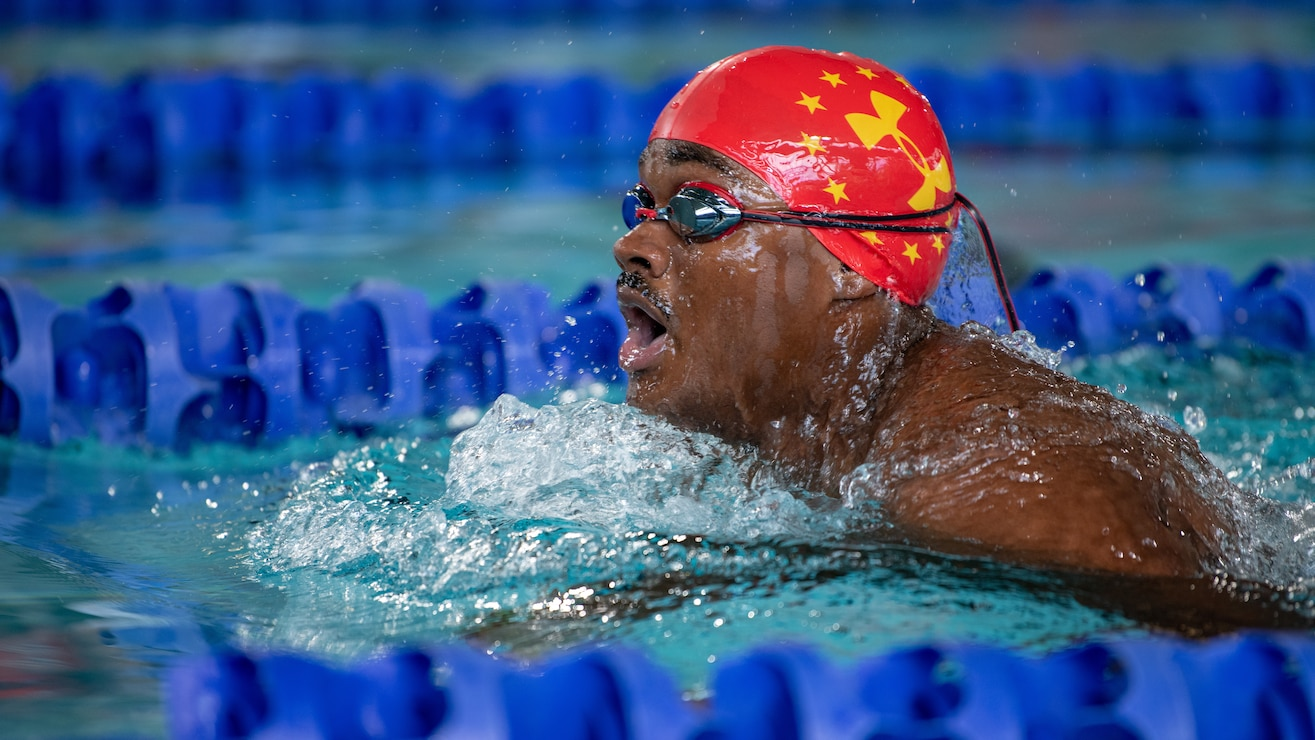 U.S. Marine Corps Lance Cpl. Carlos Jimenez takes a breath during a swimming relay at Long Aquatic Center during the 2019 DoD Warrior Games in Tampa, Florida, June 29, 2019. Jimenez would go on to earn a silver medal and two bronze medals before the swimming portion of the games came to an end. The 2019 Warrior Games consist of 13 Paralympic-style sports, and more than 300 athletes representing the U.S. Marine Corps, Army, Navy, Air Force, Special Operations Command, and five international teams.