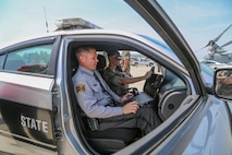 A U.S. Marine participates in a drunk driving simulator with the North Carolina State Troopers during the 2019 Fourth of July 'Booze it & Lose it' event, code-named Operation Firecracker on Marine Corps Air Station New River, July 1, 2019. The event featured speakers from the air station and local law enforcement. The goal of the event was to eliminate preventable loss of life on North Carolina roadways by discouraging driving while impaired and encouraging the public to use other safe options like ride sharing and commercial transportation. This is the first time the event has been held at Marine Corps Air Station New River, which was chosen to be the backdrop due to the large concentration of young male adults who are considered to be the most at-risk age group. (U.S. Marine Corps photo by Sgt. Jonathan Sosner)