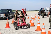 U.S. Marines participate in a simulated drunk driving exercise during the 2019 Fourth of July 'Booze it & Lose it' event, code-named Operation Firecracker on Marine Corps Air Station New River, July 1, 2019. The event featured speakers from the air station and local law enforcement. The goal of the event was to eliminate preventable loss of life on North Carolina roadways by discouraging driving while impaired and encouraging the public to use other safe options like ride sharing and commercial transportation. This is the first time the event has been held at Marine Corps Air Station New River, which was chosen to be the backdrop due to the large concentration of young male adults who are considered to be the most at-risk age group. (U.S. Marine Corps photo by Sgt. Jonathan Sosner)