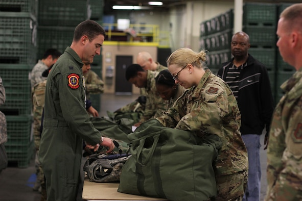 Senior Airman Casey Schlotman, material management journeyman with the 445th Logistics Readiness Squadron, assists a captain from the 60th Logistics Readiness Squadron with recovering and processing mobility gear at Travis Air Force Base, Calif. Twenty two Reserve Citizen Airmen from the 445th LRS performed their annual tour at Travis AFB May 7-23, 2019.