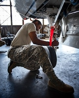 Airman Anthony Washington, 362nd Training Squadron F-16 crew chief apprentice course student, tries to connects the torque links on the front landing gear at Sheppard Air Force Base, Texas, July 2, 2019. Torque links when disconnected allows the wheel to move around more freely, they are connected before flight though as a free wheel moving in multiple directions would not be the best for landing. (U.S. Air Force photo by Airman 1st Class Pedro Tenorio)