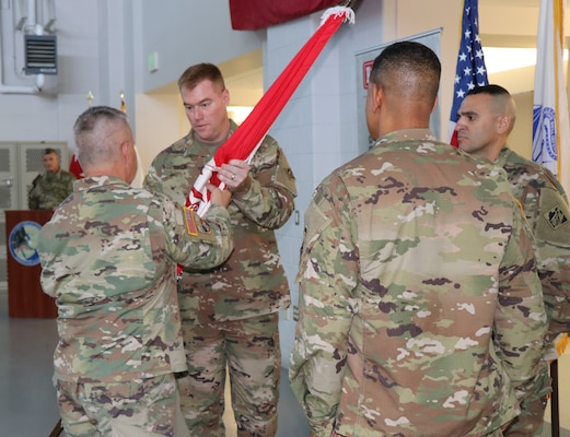 Lt. Gen. Todd T. Semonite, the 54th Chief of Engineers and U.S. Army Corps of Engineers Commanding General, passes the Transatlantic Division flag to incoming commander Col. Christopher G. Beck during a Change of Command ceremony held June 26, 2019 in Winchester, Va. The change of command is a military tradition that represents a formal transfer of authority from one commanding officer to another.