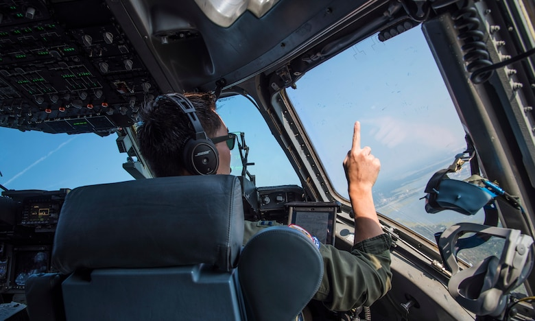 United States Air Force Captain Dennis Conner, instructor pilot with the 701st Airlift Squadron at Joint Base Charleston, South Carolina, maneuvers a C-17 Globemaster III down the coast of South Carolina July 2, 2019. A C-17 is scheduled to fly down the coast for Salute From the Shore on July 4, 2019.