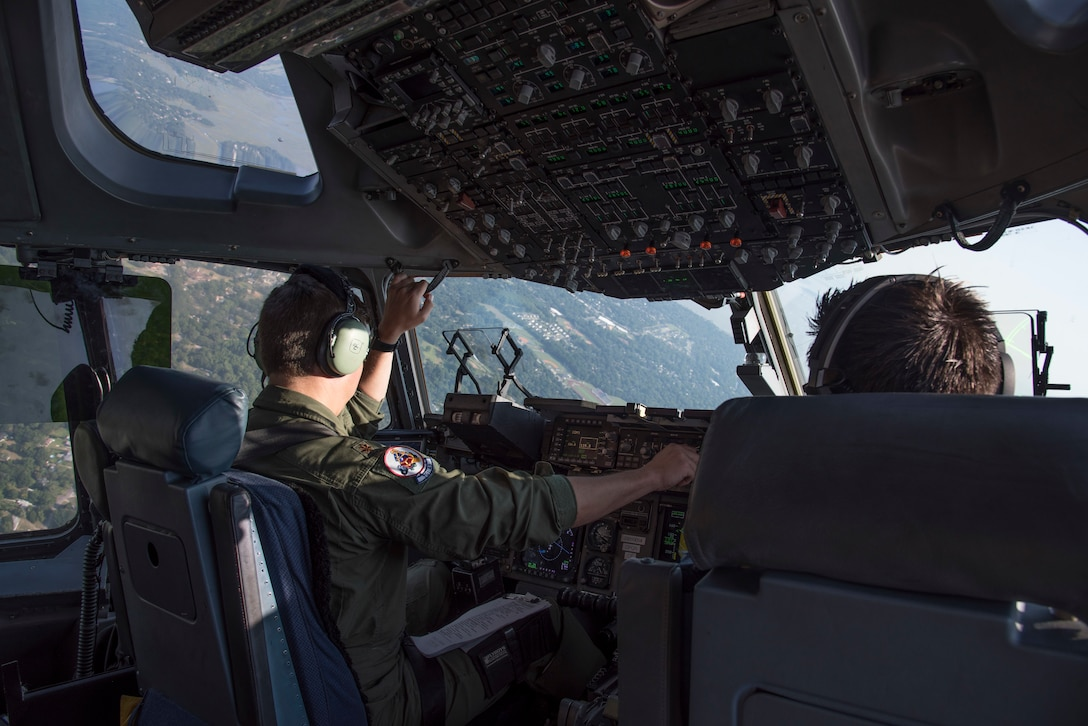 United States Air Force Major William Camp, pilot with the 701st Airlift Squadron at Joint Base Charleston, South Carolina, maneuvers a C-17 Globemaster III over Charleston, South Carolina July 2, 2019. A C-17 is scheduled to fly down the coast for Salute From the Shore on July 4, 2019.