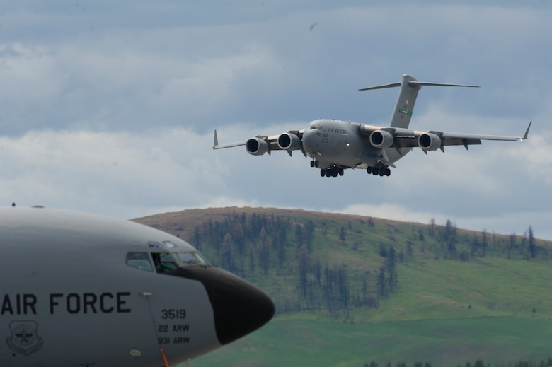 A Boeing C-17 Globemaster III flies low over the crowd at the 2019 Skyfest Open House and Air Show at Fairchild Air Force Base, Washington, June 22, 2019. Skyfest 2019 offered a unique view of Team Fairchild's role in enabling Rapid Global Mobility for the U.S. Air Force. The show featured more than 13 aerial acts and 16 static display aircraft, as well as other attractions and displays. (U.S. Air Force photo by Senior Airman Ryan Lackey)