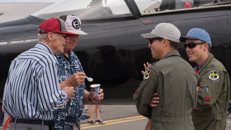Attendees converse with pilots of a T-38 Talon static display aircraft at the 2019 Skyfest Open House and Air Show at Fairchild Air Force Base, Washington, June 22, 2019. Skyfest 2019 gave the Inland Northwest a chance to meet members of Team Fairchild and see the U.S. Air Force's premier air refueling wing in action during a simulated KC-135 Stratotanker low-pass refuel of a C-17 Globemaster III.(U.S. Air Force photo by Senior Airman Ryan Lackey)