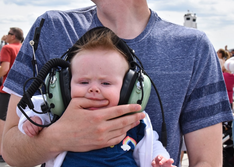 A baby chews on her father's hand at the 2019 Skyfest Open House and Airshow on Fairchild Air Force Base, Washington, June 22, 2019. Skyfest 2019 gave the Inland Northwest a chance to meet members of Team Fairchild and see the U.S. Air Force's premier air refueling wing in action during a simulated KC-135 Stratotanker low-pass refuel of a C-17 Globemaster III. (U.S. Air Force photo by Airman Kiaundra Miller)