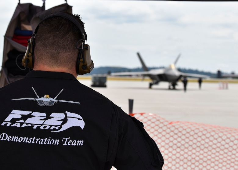 U.S. Air Force Tech. Sgt. Joey Aronson watches part of the F-22 Raptor Demonstration Team prepare to perform during the 2019 Skyfest Open House and Airshow  on Fairchild Air Force Base, June 22, 2019. Fairchild opened its gates to the public for a free one-day event to showcase Pacific Northwest airpower and U.S. Air Force capabilities. The airshow included the F-22 Demonstration Team, U.S. Army Golden Knights and 11 other aerial acts. (U.S. Air Force photo by Airman Kiaundra Miller)