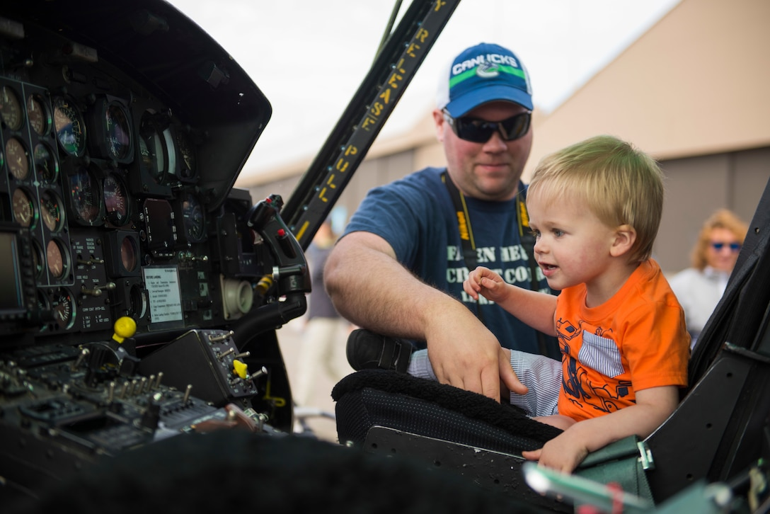 Porter, a Skyfest 2019 visitor,  sits inside the flightdeck of a UH-1N Huey during the Skyfest 2019 Open House and Airshow at Fairchild Air Force Base, Washington, June 22, 2019. Skyfest 2019 Open House and Airshow offered a unique view of Team Fairchild's role in enabling Rapid Global Mobility for the U.S. Air Force. The show featured more than 13 aerial acts and 16 static display aircraft, as well as other attractions and displays. (U.S. Air Force photo by Airman 1st Class Lawrence Sena)