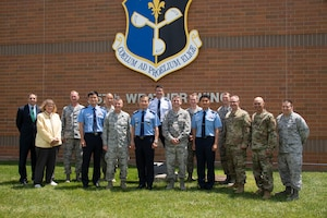 Members of the 557th Weather Wing and Republic of Korea Air Force Weather Wing pose for a group photo in front of the 557th WW headquarters building at Offutt Air Force Base, Nebraska, June 20, 2019. The biennial meeting between the 557th WW and ROKAF allows for a synchronization of priorities and lays the groundwork for future cooperation. (U.S. Air Force photo by Paul Shirk)