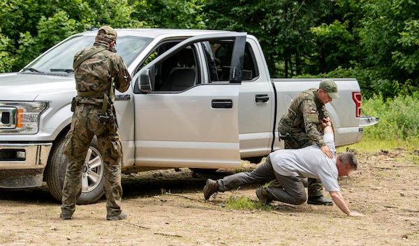 Members of the Polish Territorial Defense Forces receive training in checkpoint vehicle clearing techniques from members of West Virginia Army National Guard (WVARNG) Special Forces during Ridge Runner 19-02, June 24, 2019, in West Virginia. Ridge Runner is a WVARNG training program that provides various National Guard, active duty, and North Atlantic Treaty Organization (NATO) ally nation armed forces with training in irregular and asymmetrical warfare tactics and operations. Photo was altered for security reasons.