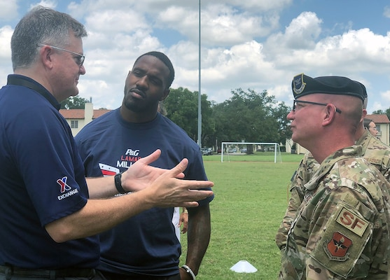 Houston Texans running back Lamar Miller (center) hosted a football camp for about 150 Joint Base San Antonio-Randolph Air Force Base youth from the first through eighth grades July 1-2. Miller, who has been with the Texans for three seasons, led the football camp to help military children to learn the game of football and live healthier lifestyles.