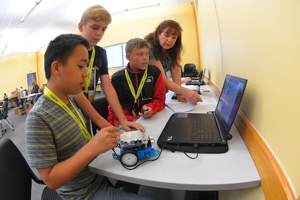 Students write code to program robots with instruction from instructor Patricia Bodley during a LEGACY (Leadership Experience Growing Apprenticeships Committed to Youth) program camp June 26, 2019, at the Freeport Center in Clearfield, Utah. LEGACY is an Air Force program aimed at building interest in science, technology, engineering and math (STEM) through hands-on activities while showing how STEM applies to the world. (U.S. Air Force photo by Todd Cromar)