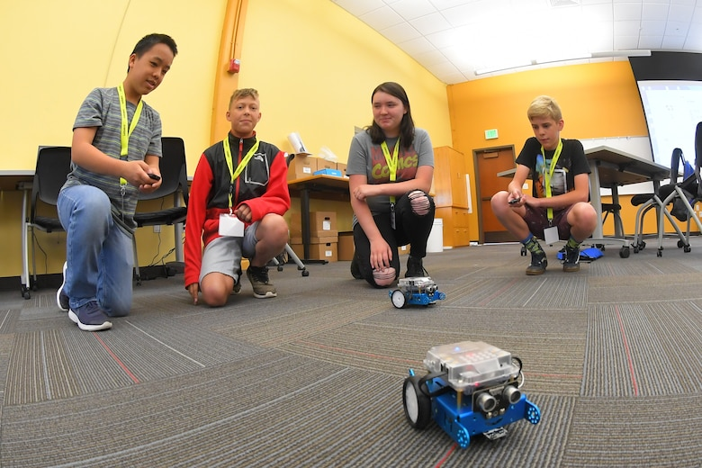 – Students test robots they programmed during a LEGACY (Leadership Experience Growing Apprenticeships Committed to Youth) program camp June 26, 2019, at the Freeport Center in Clearfield, Utah. LEGACY is an Air Force program aimed at building interest in science, technology, engineering and math (STEM) through hands-on activities while showing how STEM applies to the world. (U.S. Air Force photo by Todd Cromar)