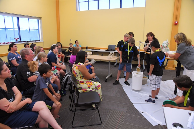 Students test boom lever's they constructed during a LEGACY (Leadership Experience Growing Apprenticeships Committed to Youth) program camp June 28, 2019, at the Freeport Center in Clearfield, Utah. LEGACY is an Air Force program aimed at building interest in science, technology, engineering and math (STEM) through hands-on activities while showing how STEM applies to the world. (U.S. Air Force photo by Todd Cromar)