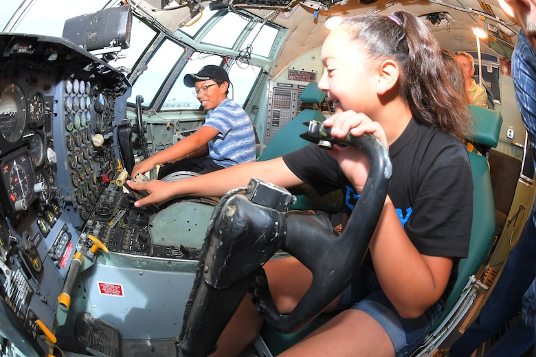 (Left to right) Students Adrian Sanchez and Jocelyn Martinez manipulate the controls of a C-130 aircraft at the Hill Aerospace Museum during a LEGACY (Leadership Experience Growing Apprenticeships Committed to Youth) program field trip June 14, 2019, at Hill Air Force Base, Utah. LEGACY is an Air Force program aimed at building interest in science, technology, engineering and math (STEM) through hands-on activities while showing how STEM applies to the world. (U.S. Air Force photo by Todd Cromar)