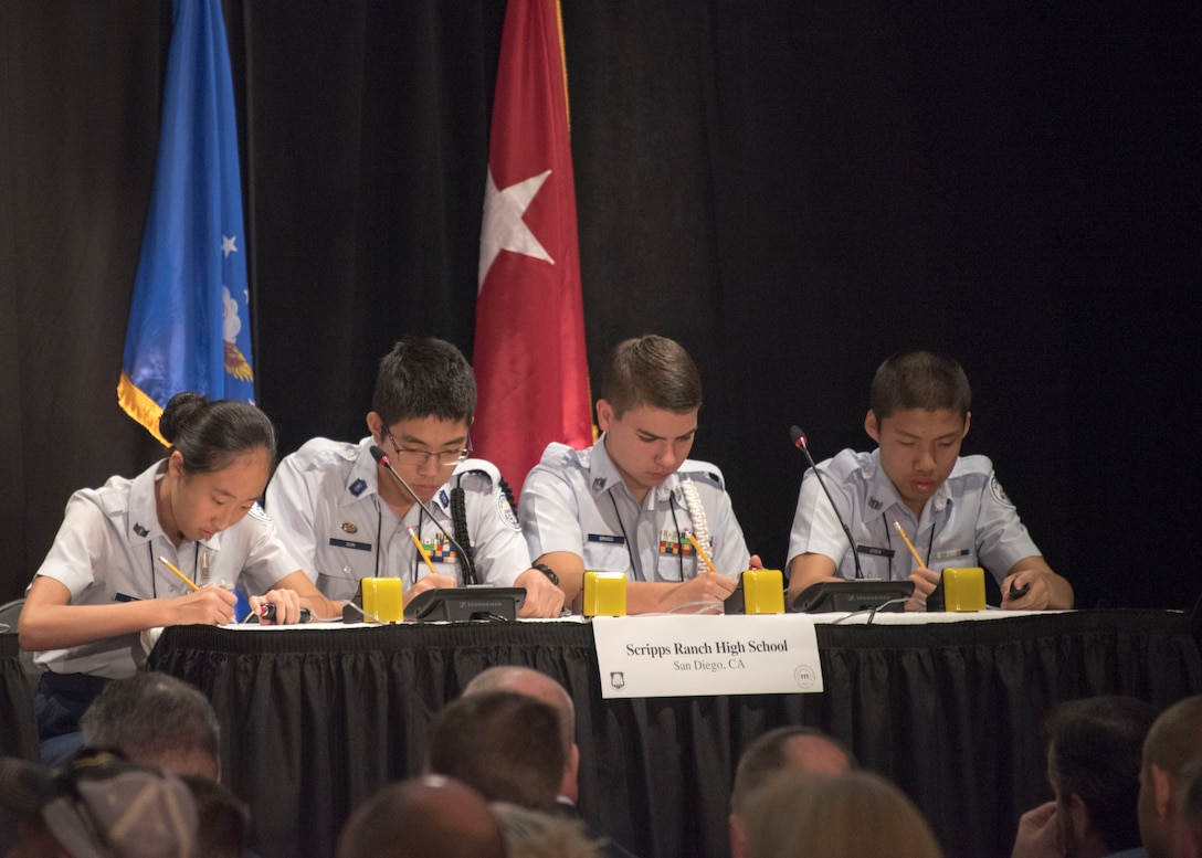 Air Force Junior Reserve Officer Training Corps team from Scripps Ranch High School, San Diego Calif., use pencil and paper to answer a math question during the finals of the  a question in which requited pencil and paper during the 8th Annual Joint Service Academic Bowl, in Washington, D.C., June 23, 2019. The team competed against more than 430 Air Force JROTC teams to make it to the finals after months of testing and competing. (Air Force Photo by Staff Sgt. Jared Duhon)