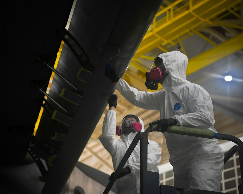 Airman 1st Class Austin Plaugher and Senior Airman Spencer Coole, aircraft structural maintenance technicians from the 437th Maintenance Squadron, prepare to apply the outer coating of aircraft paint to a C-17 Globemaster III July 2, 2019 at Joint Base Charleston, S.C. The technicians at JB Charleston maintain C-17s in support of maintaining a global reach airlift capability. Structural maintenance technicians advise on and maintain the structural and low observable repair, modification and corrosion protection treatment of various types of aircraft.