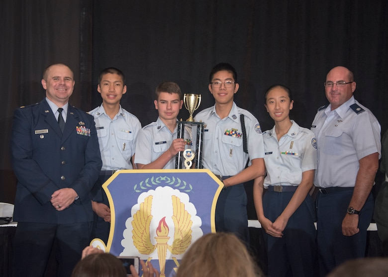 Cadets Samuel Chen, Kevin Griggs, Raymond Sun and Vanessa Zhou from Scripps Ranch High School, San Diego, Calif., celebrate second place with Maj. Michael Allen (left), operations deputy of Air Force JROTC, and Lt. Col. Michael Sheldon (right), JROTC instructor at Scripps Ranch High School during the 8th Annual JROTC Leadership and Academic Bowl award ceremony, in Washington, D.C., June 24, 2019.The Junior ROTC Academic Bowl is a multi-level competition that high school Junior ROTC units from each service participate in throughout the school year. The competition includes a mix of Junior ROTC curriculum, English, Math and Science, all skills that contribute to the Air Force Junior ROTC core mission of developing citizens of character. (Air Force Photo by Staff Sgt. Jared Duhon)