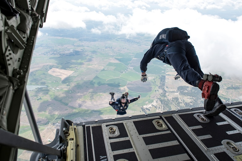 U.S. Air Force Academy Wings of Blue team members Steve Rumsey and Trevor Pratt, , leap off of the C-130 Hercules ramp from 7,700 feet to the ground bellow during the 2019 Skyfest Open House and Airshow performance at Fairchild Air Force Base, Washington, June 22, 2019. Skyfest 2019 offered a unique view of Team Fairchild's role in enabling Rapid Global Mobility for the U.S. Air Force. The show featured more than 13 aerial acts and 16 static display aircraft, as well as other attractions and displays. (U.S. Air Force photo by Airman 1st Class Whitney Laine)