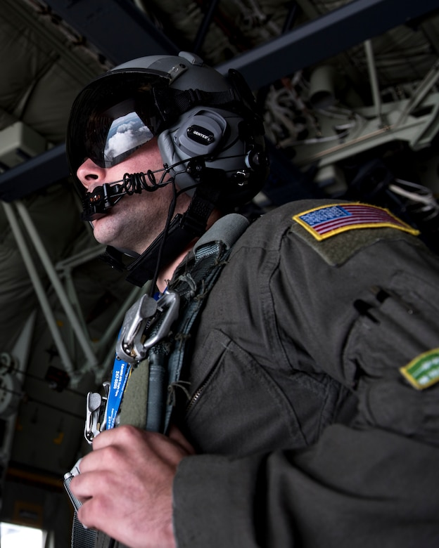 U.S. Air Force Airman 1st Class Nick Hooker, 61st Airlift Squadron loadmaster, waits for the wind to settle for the next U.S. Air Force Academy Wings of Blue parachute team to bound off of the C-130 Hercules's ramp from 7,700 feet to the ground during the 2019 Skyfest Open House and Airshow performance at Fairchild Air Force Base, Washington, June 22, 2019. Fairchild opened its gates to the public for a free one-day event to showcase Pacific Northwest airpower and U.S. Air Force capabilities. The airshow included the F-22 Demonstration Team, U.S. Army Golden Knights and 11 other aerial acts. (U.S. Air Force photo by Airman 1st Class Whitney Laine)