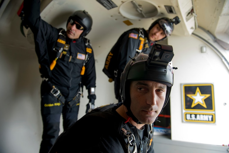 Members of the U.S. Army Golden Knights parachute team receive jump condition information prior to jumping during the Skyfest 2019 Open House and Air Show at Fairchild Air Force Base, Washington, June 22, 2019. Fairchild opened its gates to the public for a free one-day event to showcase Pacific Northwest airpower and U.S. Air Force capabilities. The airshow included the F-22 Demonstration Team, U.S. Army Golden Knights and 11 other aerial acts. (U.S. Air Force photo by Airman 1st Class Lawrence Sena)