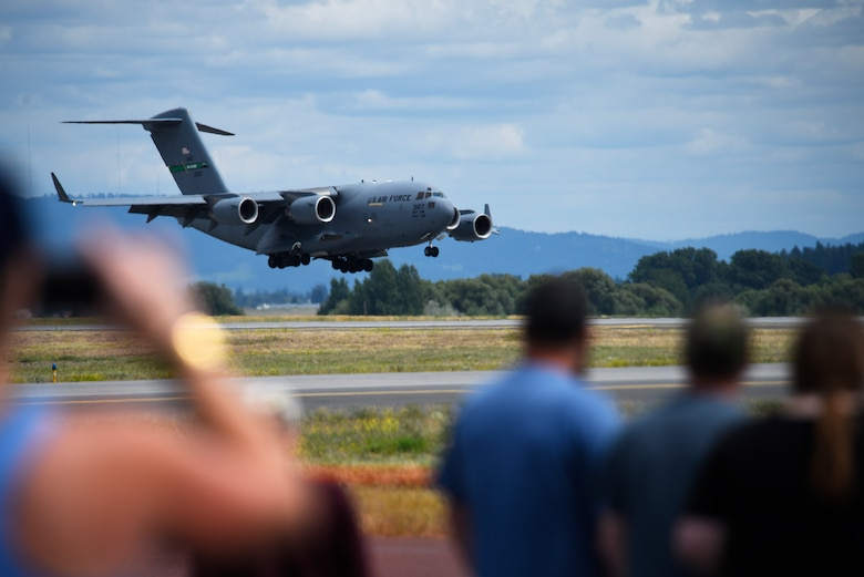 A C-17 Globemaster III prepares to land during the Skyfest 2019 Open House and Airshow at Fairchild Air Force Base, Washington, June 22, 2019. Skyfest 2019 gave the Inland Northwest a chance to meet members of Team Fairchild and see the U.S. Air Force's premier air refueling wing in action during a simulated KC-135 Stratotanker low-pass refuel of a C-17 Globemaster III. ( U.S. Air Force photo by Airman 1st Class Lawrence Sena)