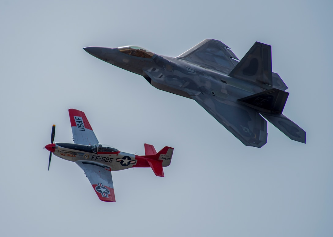 An F-22 Raptor and a P-51 Mustang perform a Heritage Flight during the 2019 Skyfest 2019 Open House and Air Show at Fairchild Air Force Base, Washinton, June 22, 2019. Skyfest 2019 Open House and Airshow offered a unique view of Team Fairchild's role in enabling Rapid Global Mobility for the U.S. Air Force. The show featured more than 13 aerial acts and 16 static display aircraft, as well as other attractions and displays. (U.S. Air Force photo by Airman 1st Class Lawrence Sena)