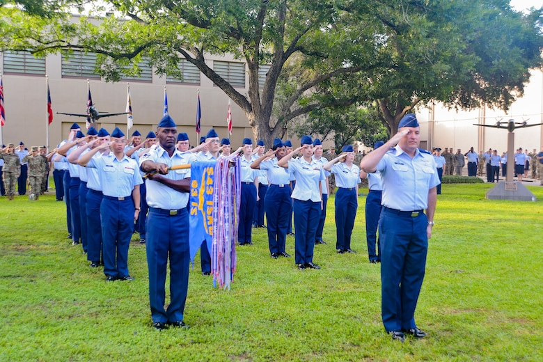 U.S. Air Force Airmen assigned to the 543rd Intelligence, Surveillance and Reconnaissance Group salute during the presentation of the colors at a change of command ceremony at Joint Base San Antonio-Lackland, Texas, July 1, 2019. Col. Tara Mehue, outgoing 543rd ISR Group commander, relinquished command to Col. Ty Gilbert. (U.S. Air Force photo by Sharon Singleton)
