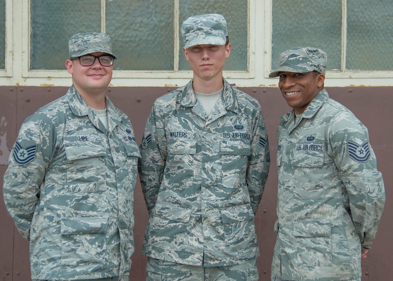 U.S. Air Force Tech. Sgt. Casey Lipe, 792nd Intelligence Support Squadron Mission Defense Team members NCO in charge, Senior Airman Gage Walters, 792nd ISS MDT member, and Tech. Sgt. Lavelle Burgess, 792nd ISS MDT NCOIC of mission defense programming, pose for a group photo at Joint Base Pearl Harbor-Hickam, Hawaii, June 26, 2019. The MDT created the Functional Research Innovation Systems for Brainstorming and Evaluation Environment, or FRISBEE Lab, as a virtual testing ground for their shop, which has become an integral training tool. (U.S. Air Force photo by Senior Airman Douglas Lorance)