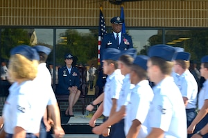 U.S. Air Force Col. Heather Blackwell, 81st Training Wing commander, and Col. Leo Lawson Jr., outgoing 81st Training Group commander, watch Airmen march in formation during the 81st TRG change of command ceremony at the Levitow Training Support Facility drill pad at Keesler Air Force Base, Mississippi, July 1, 2019. The ceremony is a symbol of command being exchanged from one commander to the next. Lawson passed command of the 81st TRG to Col. Chance Geray, incoming 81st TRG commander. (U.S. Air Force photo by Airman Seth Haddix)