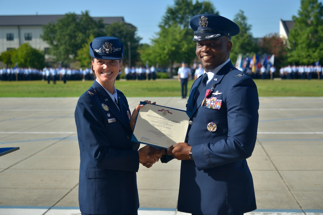 U.S. Air Force Col. Heather Blackwell, 81st Training Wing commander, presents the Legion of Merit award to Col. Leo Lawson Jr., outgoing 81st Training Group commander, during the 81st TRG change of command ceremony at the Levitow Training Support Facility drill pad at Keesler Air Force Base, Mississippi, July 1, 2019. Lawson's next assignment is to United States Transportation Command. (U.S. Air Force photo by Airman Seth Haddix)