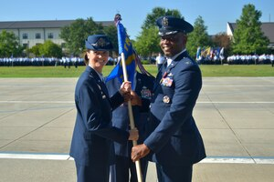 U.S. Air Force Col. Heather Blackwell, 81st Training Wing commander, takes the guidon from Col. Leo Lawson Jr., outgoing 81st Training Group commander, during the 81st TRG change of command ceremony at the Levitow Training Support Facility drill pad at Keesler Air Force Base, Mississippi, July 1, 2019. The ceremony is a symbol of command being exchanged from one commander to the next. Lawson passed on command of the 81st TRG to Col. Chance Geray, incoming 81st TRG commander. (U.S. Air Force photo by Airman Seth Haddix)