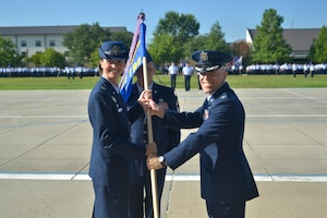 U.S. Air Force Col. Heather Blackwell, 81st Training Wing commander, passes the 81st Training Group guidon to Col. Chance Geray, 81st TRG commander, during the 81st TRG change of command ceremony at the Levitow Training Support Facility drill pad at Keesler Air Force Base, Mississippi, July 1, 2019. The passing of the guidon is a ceremonial symbol of exchanging command from one commander to another. Geray assumed command of the 81st Training Group from Col. Leo Lawson Jr., outgoing 81st TRG commander. (U.S. Air Force photo by Airman Seth Haddix)