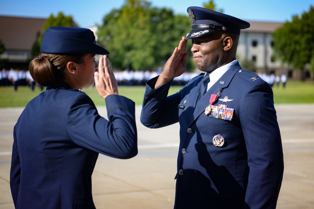 U.S Air Force Col. Leo Lawson Jr., outgoing 81st Training Group commander, salutes Col. Heather Blackwell, 81st Training Wing commander, after receiving the Legion of Merit medal during the 81st TRG change of command ceremony at the Levitow Training Support Facility drill pad on Keesler Air Force Base, Mississippi, July 1, 2019. The ceremony is a symbol of command being exchanged from one commander to the next by the handing-off of a ceremonial guidon. Lawson's next assignment is to United States Transportation Command. (U.S Air Force photo by Airman 1st Class Spencer Tobler)