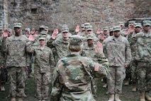Col. Michelle M.T. Letcher, commander of the 16th Sustainment Brigade, administers the oath of reenlistment to 53 Soldiers during a mass reenlistment ceremony in Kusel, Germany. More than 80 percent of eligible Soldiers have already reenlisted in fiscal year 2019, surpassing the Army's targeted goal five months early.