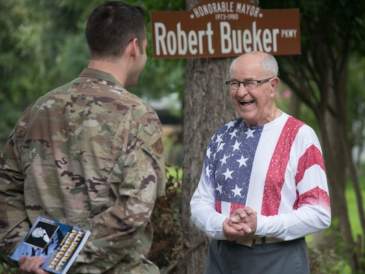 Robert C. Bueker, a local retiree and former World War II prisoner of war laughs with First Lt. Christian Eberhardt, 502d Air Base Wing Public Affairs Officer at his home July 3, 2019. Bueker celebrated his 95th birthday a day early with the help of Joint Base San Antonio presenting him with a personalized letter from Col. Mark Robinson, commander of the 12th Flying Training Wing, and a flag that has been flown onboard an F-16 during 2017 support operations in Afghanistan. (U.S. Air Force photo by: Airman 1st Class Shelby Pruitt)