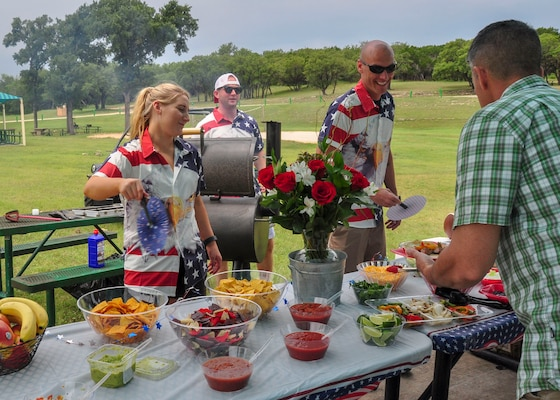 The 502nd Air Base Wing's command section enjoy lunch during their resiliency day at Canyon Lake June 11, 2019. For the 502nd ABW command staff function, the UNITE program provided funding for the food, $5 per member.