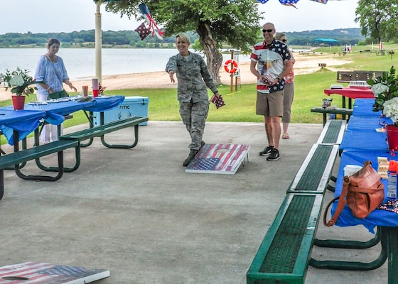 Brig. Gen. Laura Lenderman, 502nd Air Base Wing and Joint Base San Antonio commander and Capt. Nathan Spradley, 502nd ABW commander's action group, play corn hole during the 502nd ABW command section's resiliency day at Canyon Lake June 11, 2019. For the 502nd ABW command staff function, the Unite program provided funding for food, $5 per member.