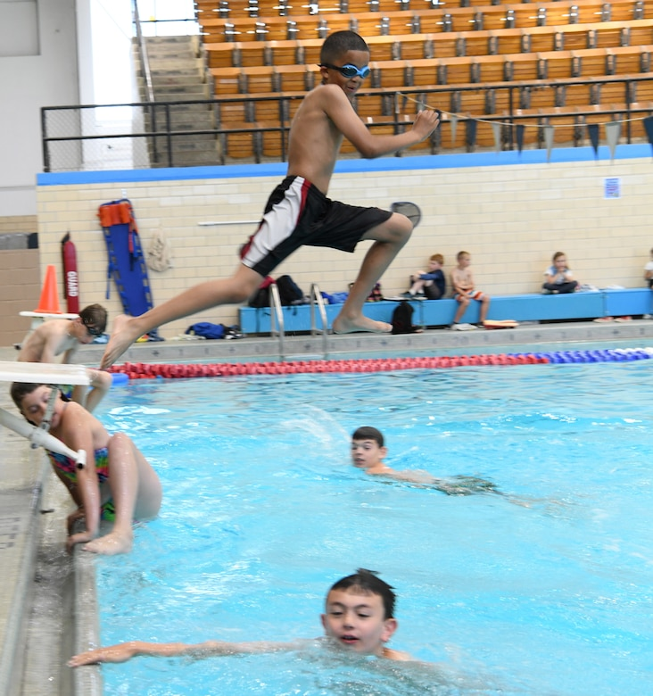 Children swim at the Summer Splash event at Ellsworth Air Force Base, S.D., July 1, 2019. The 28th Force Support Squadron hosted a pool party at the Bellamy Fitness Center where participants were able to escape the heat with a dip in the pool. (U.S. Air Force photo by Senior Airman Thomas Karol)