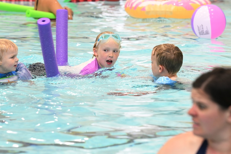 A child swims at the Summer Splash event at Ellsworth Air Force Base, S.D., July 1, 2019. The 28th Force Support Squadron hosted a pool party at the Bellamy Fitness Center where participants were able to escape the heat with a dip in the pool. (U.S. Air Force photo by Senior Airman Thomas Karol)