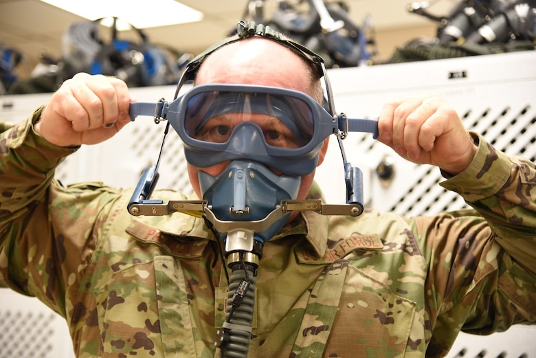 Tech. Sgt. Ronald Patton, 403rd Operation Support Squadron aircrew flight equipment craftsman, demonstrates how to put on the old anti-smoke goggles that has been used for more than 20 years at Keesler Air Force Base, Mississippi. The new ASGs are an easier quick don system, that now has the eye piece and nose/mouth cover as one single piece, similar to those used by firefighters, and will be in place on the aircraft by the middle of August 2019. (U.S. Air Force photo by Jessica L. Kendziorek)
